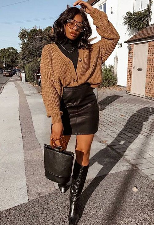 a sexy fall look with a black turtleneck, a brown cardigan, a black leather mini skirt, black boots and a black bucket bag