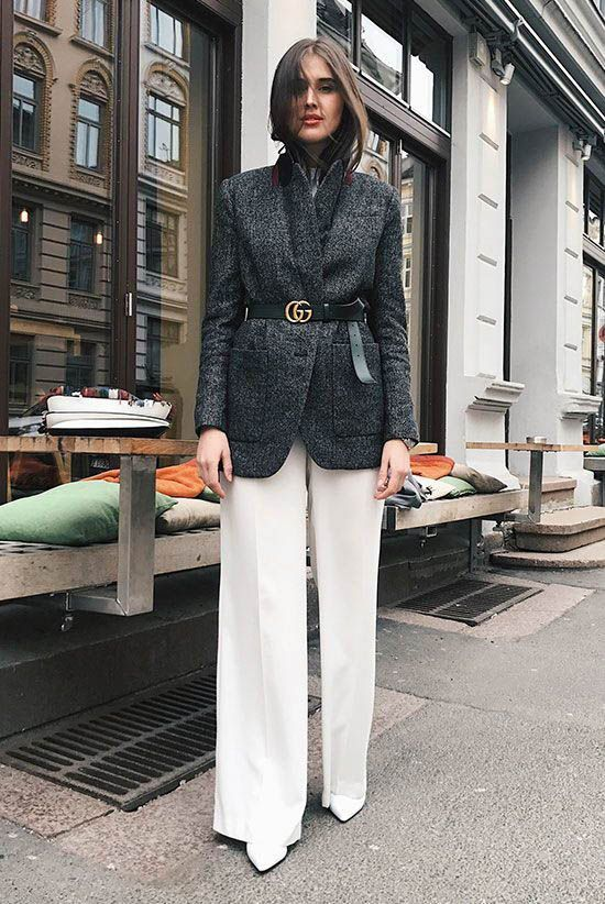 a lovely fall work look with a grey oversized blazer, a logo belt, white trousers and white boots is amazing