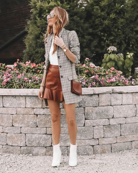 a white t-shirt, an amber leather mini skirt, white boots, a grey plaid blazer and a brown mini bag
