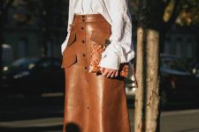 24 a trendy fall look with an oversized white shirt, an amber leather A-line midi, snakeskin print boots and a clutch