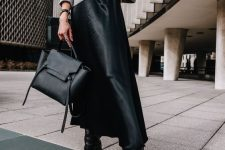 25 a grey sweater, a black slip midi skirt, black boots and a black bag compose a stylish look suitable for work