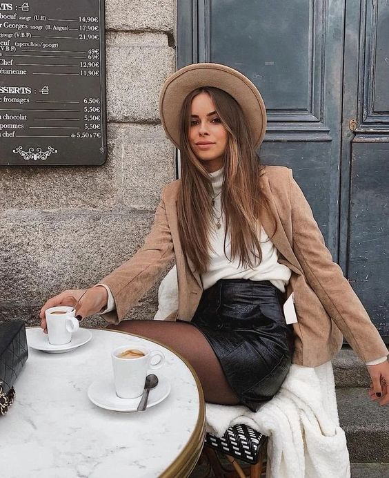 a fall look with a white jumper, a black leather mini, black tights, a tan blazer and a tan hat is very cool