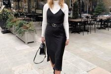 29 a timeless fall outfit with a white turtleneck, a black slip midi dress, black boots and a black bag
