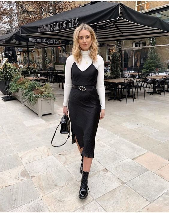 a timeless fall outfit with a white turtleneck, a black slip midi dress, black boots and a black bag