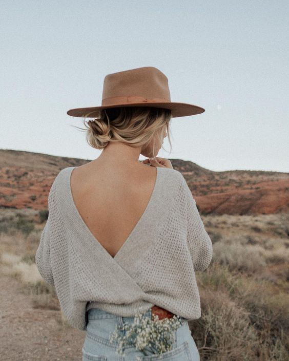 a cute fall look with a grey open back jumper, bleached jeans and a tan hat is very stylish and relaxed