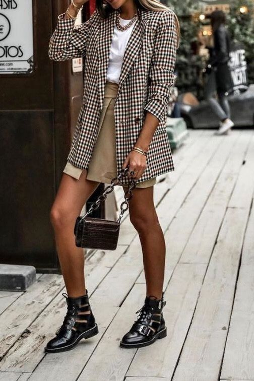 a lovely fall outfit with a white tee, a tan wrap mini skirt, a plaid oversized blazer, black cutout booties and a burgundy bag