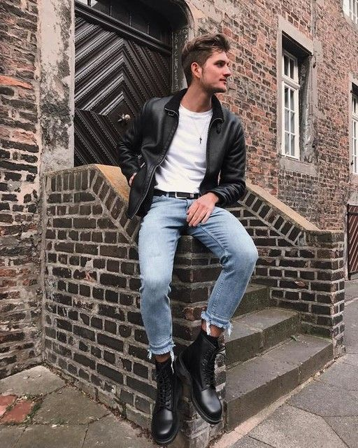 a white tee, blue jeans, a black leather jacket, black leather boots for a stylish rock-inspired look