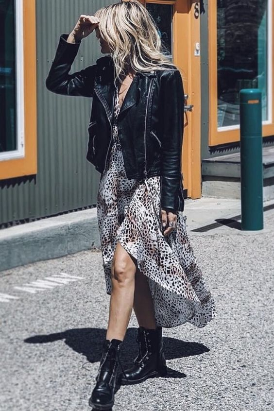 a pretty fall look with a snakeskin print midi dress, a black leather jacket, black boots is lovely