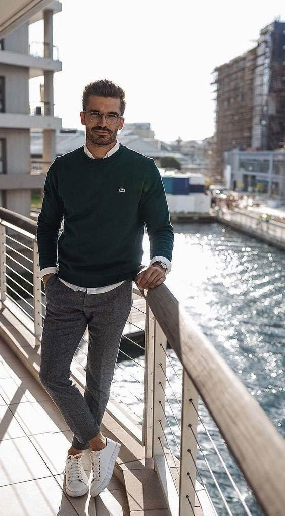 a white shirt, a dark green jumper, grey trousers, white sneakers for a stylish business casual outfit