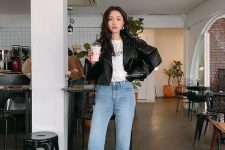 34 a basic look with a white printed tee, a black oversized leather jacket, blue jeans, black sneakers and socks