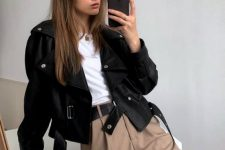 35 a stylish basic fall look with tan high waisted pants, a white tee, a black cropped leather jacket is chic