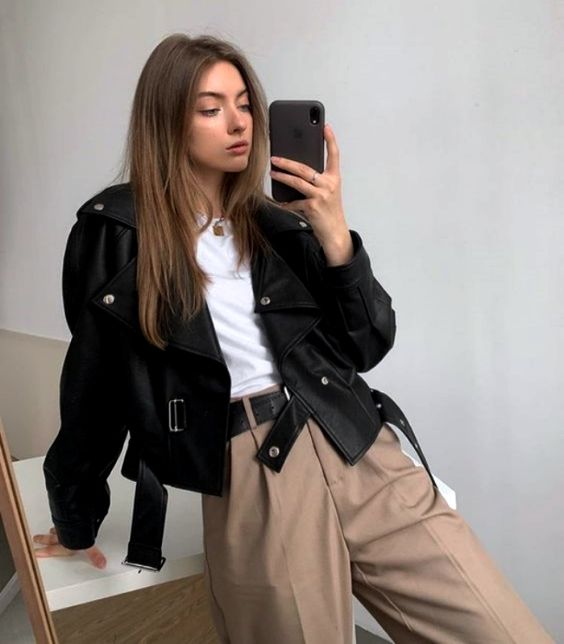 a stylish basic fall look with tan high waisted pants, a white tee, a black cropped leather jacket is chic