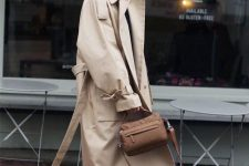 36 a stylish work look with a black turtleneck, blue jeans, white boots, a tan trench and a brown bag