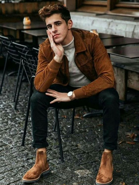 a white turtleneck, black jeans, a brown sude jacket and matching Chelsea boots for a stylish fall-themed look