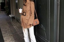 37 a relaxed look with a short tan trench with a belt, white jeans, tan silngbacks and a tan bag