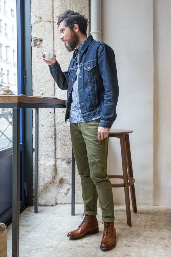 a printed blue shirt, green trousers, a blue denim jacket, brown boots for a stylish everyday or work look