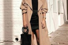 38 a stylish fall look with a black top, a black mini, a tan oversized trench, tan mules and a black bucket bag