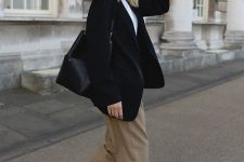 39 a work look with a white tee, a black blazer, taupe trousers, white sneakers and a black bag