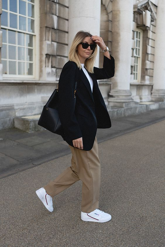 a work look with a white tee, a black blazer, taupe trousers, white sneakers and a black bag