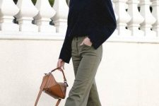 40 a black sweater, gren cropped jeans, white sneakers, a brown mini bag for a cold day