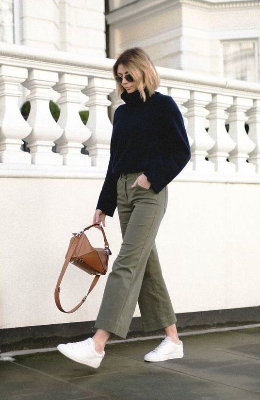a black sweater, gren cropped jeans, white sneakers, a brown mini bag for a cold day