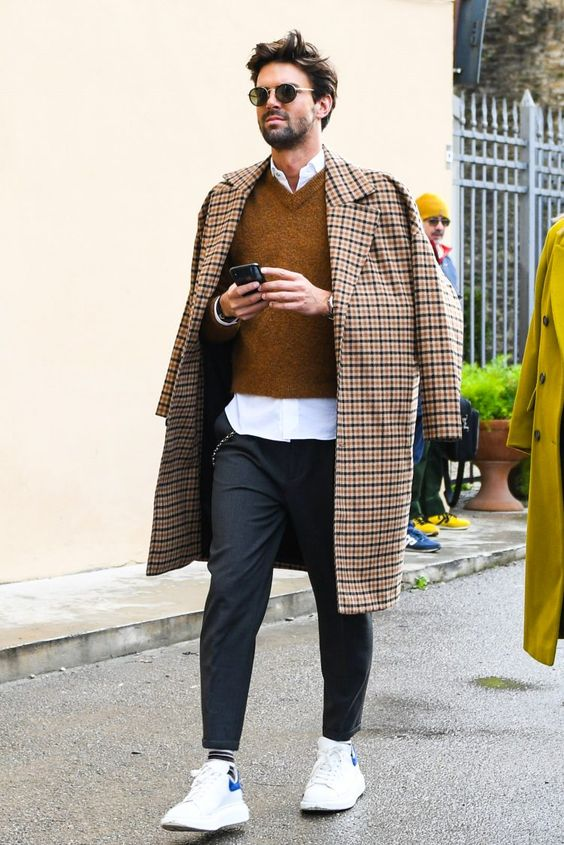 a white shirt, a mustard jumper, grey trousers, white sneakers and a plaid coat for a very stylish fall look