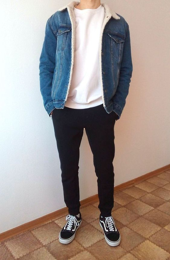 a simple outfit with a white sweatshirt, black sweatpants, black sneakers, a blue denim jacket with faux fur
