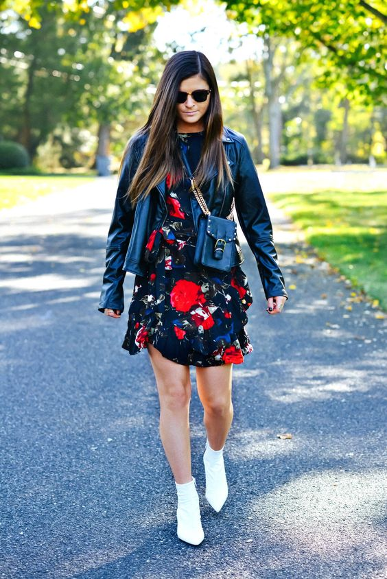 a bright and moody mini dress, a black leather jacket, a black crossbody bag and white ankle boots