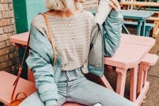 44 a cute fall outfit with a striped tee, bleached jeans, a mint green bomber jacket, an orange cap and a bag