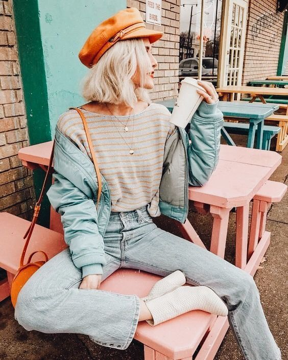 a cute fall outfit with a striped tee, bleached jeans, a mint green bomber jacket, an orange cap and a bag