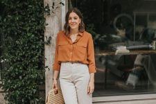 45 a pretty and bright outfit with a rust-colored shirt, white jeans, brown loafers, a woven bag for every day