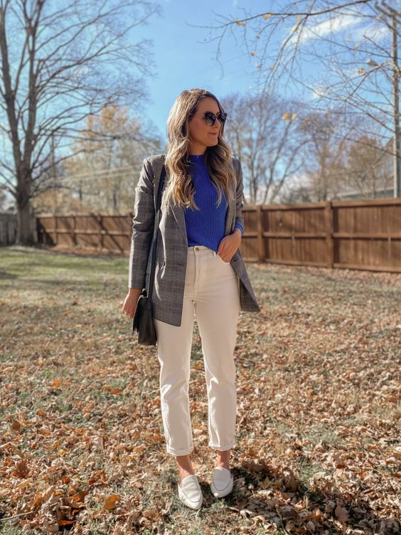 an electric blue jumper, white jeans, white loafers, a grey plaid blazer, a black crossbody bag for fall