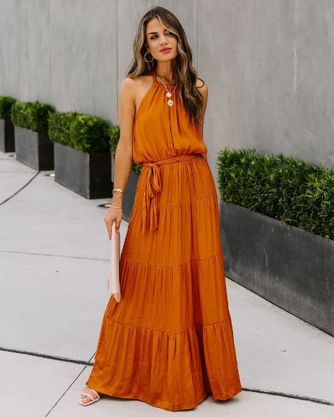 With beige clutch and white sandals