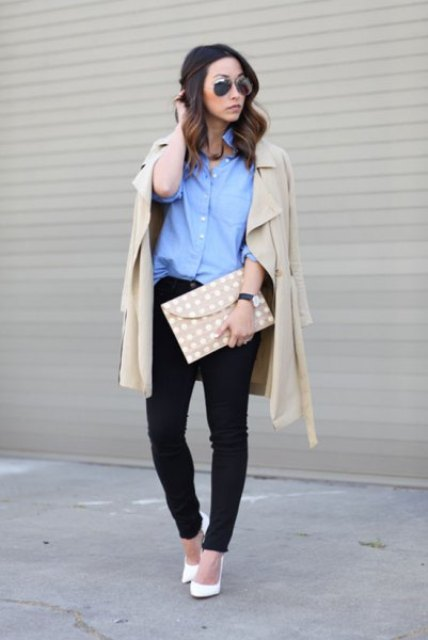With beige coat, black trousers, polka dot clutch and white pumps