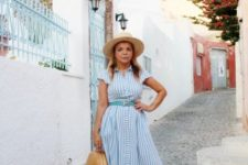 With beige hat, brown bag and printed mules