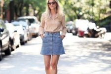 With beige long sleeved shirt and brown lace up high heels