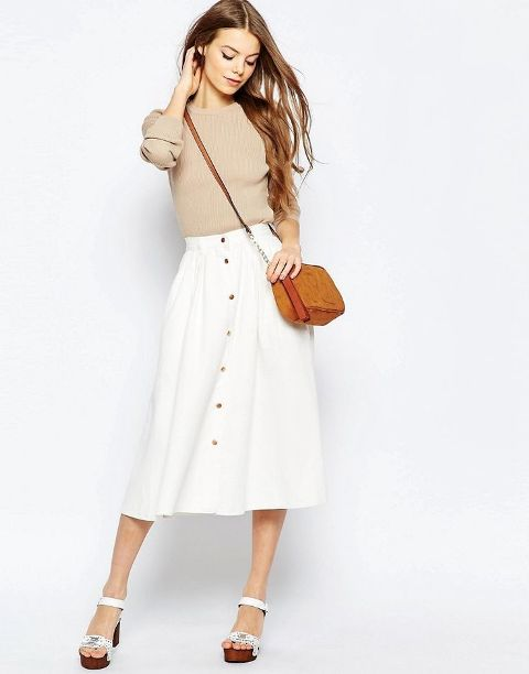 With beige shirt, brown crossbody bag and white platform sandals