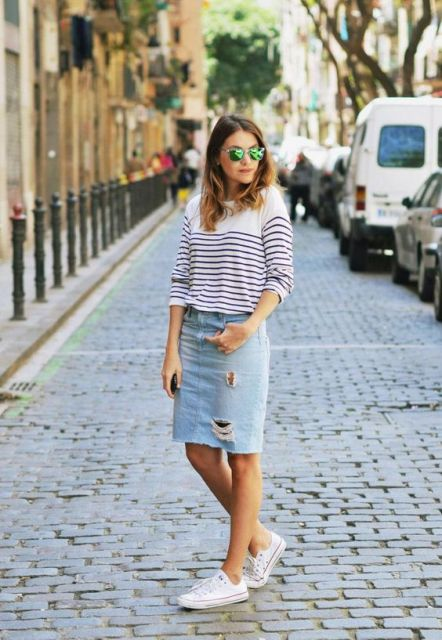 With black and white striped shirt and white flat shoes