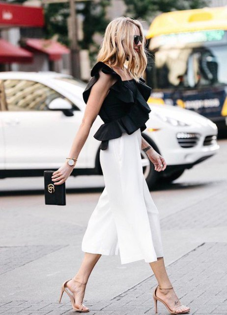 With black clutch, white culottes and beige high heels