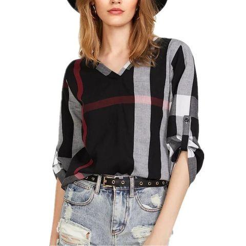 With black hat, distressed jeans and black embellished belt