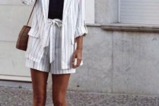With black lace top, white sneakers and brown bag