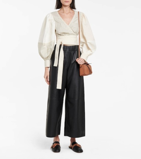 With black leather palazzo pants, brown bag and black and brown flat mules