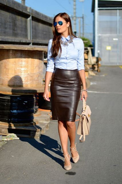 With black leather pencil skirt, beige bag and beige high heels