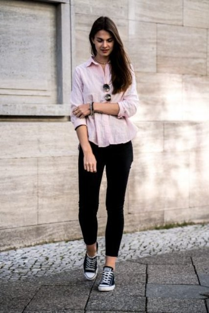 With black pants and black and white sneakers