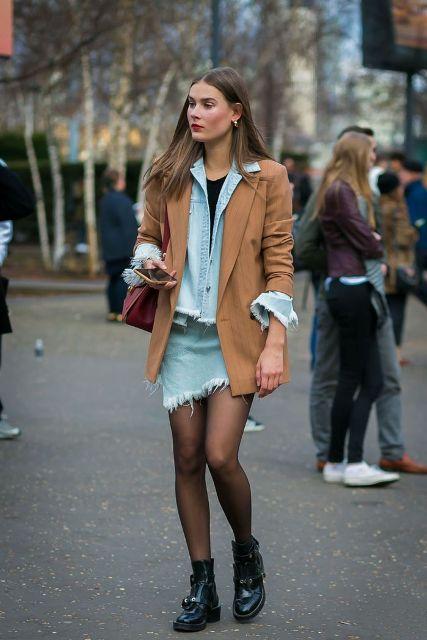 With black t-shirt, denim jacket, brown blazer and black flat boots