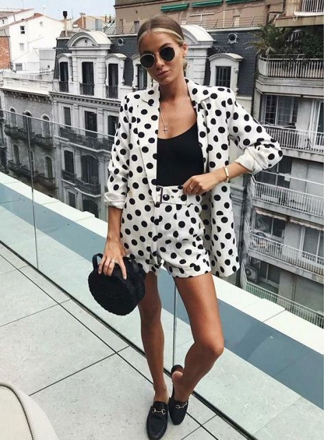 With black top, black rounded bag and flat mules
