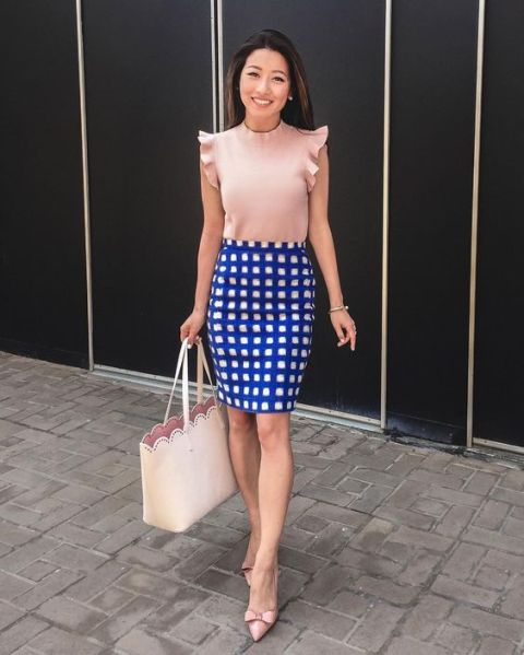 With blue and white checked skirt, beige tote bag and pale pink shoes