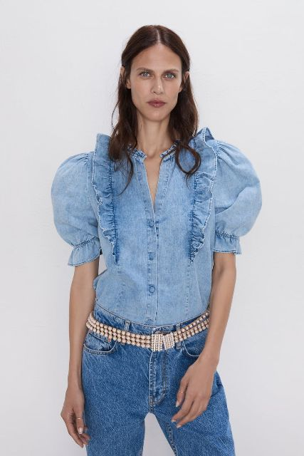 With classic jeans and embellished belt