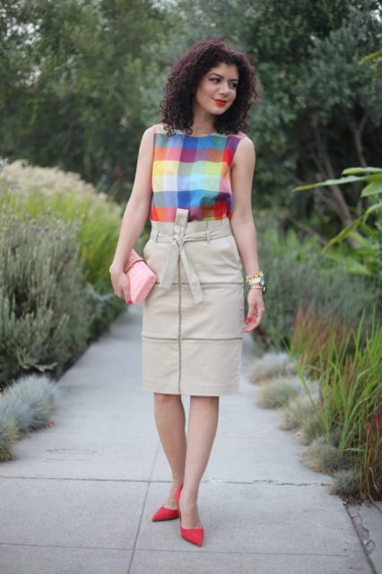 With colorful checked shirt, pale pink clutch and red pumps
