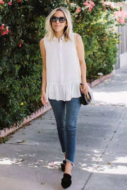With cropped jeans, black flat shoes and chain strap bag